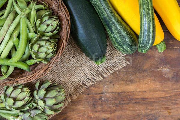 Stock photo: Fresh organic green vegetables on wooden floor