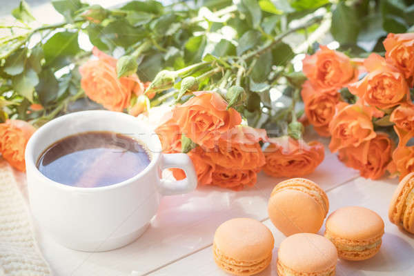 Stock photo: Orange macaroons, cup of coffee and fresh roses
