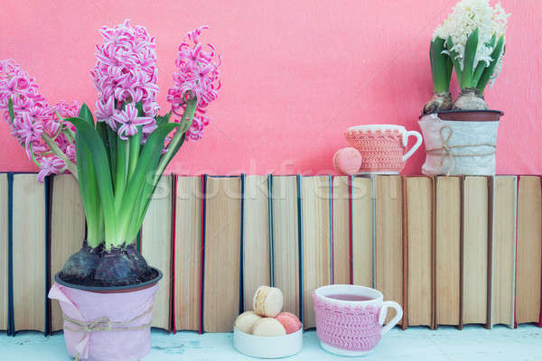 Stock photo: Pink hyacinths, macaroons, tea cups and white hyacinths near pil