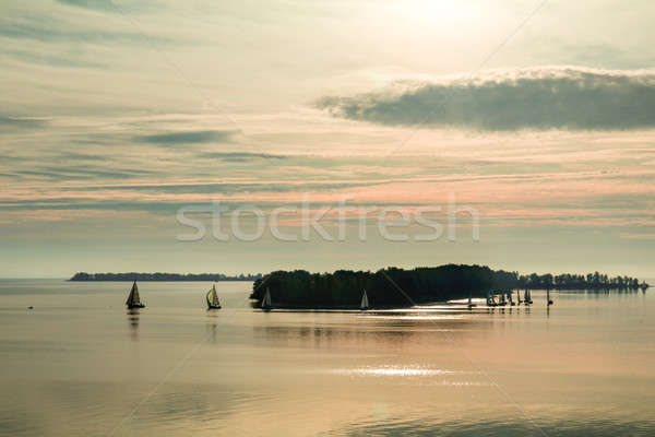 Stock photo: Sunrise over the river with yachts on a calm water surface