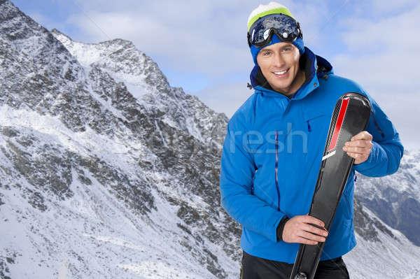 美 笑みを浮かべて 男 冬 山 笑顔 ストックフォト © arturkurjan
