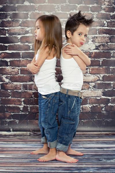 Stock photo: Two resentful kids in studio