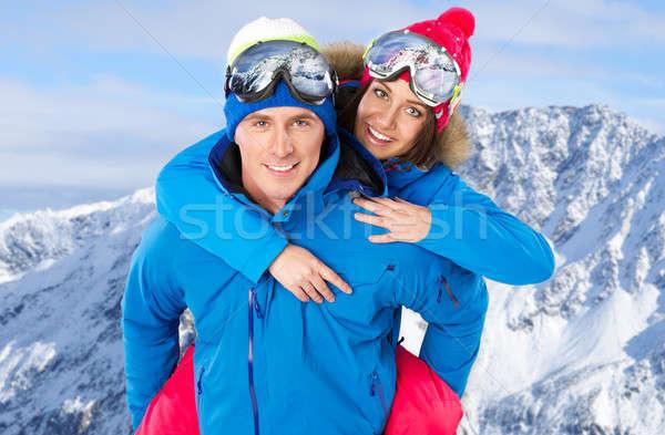 Cute paar snowboard kostuums glimlach Stockfoto © arturkurjan