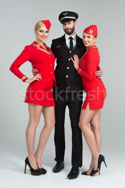 Happy group of pilots and stewardesses Stock photo © arturkurjan