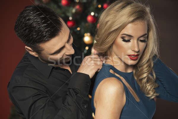 Stockfoto: Gelukkig · paar · kerstboom · glimlach · liefde · kus