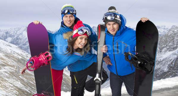 Csoport derűs barátok égbolt nők hó Stock fotó © arturkurjan