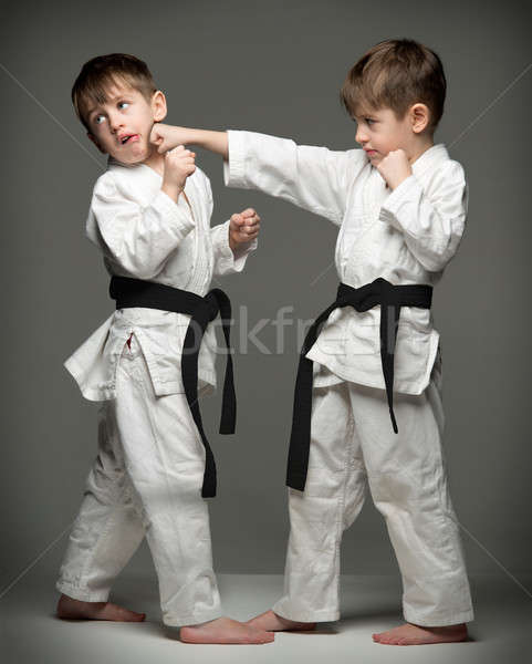 Little boys in uniform practicing judo. The same person two times Stock photo © arturkurjan
