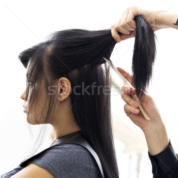 Stock photo: Woman in hairdressing salon do hair style.