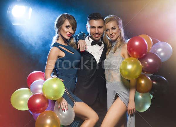Happy young people celebrating new year's eve Stock photo © arturkurjan