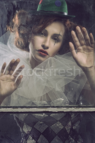 Triste femme derrière verre solitaire visage Photo stock © arturkurjan