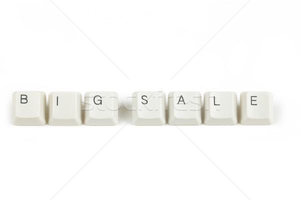 big sale from scattered keyboard keys on white Stock photo © artush