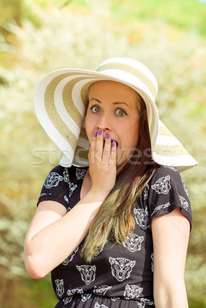 Grimace portrait of cheerful fashionable woman with hat Stock photo © artush