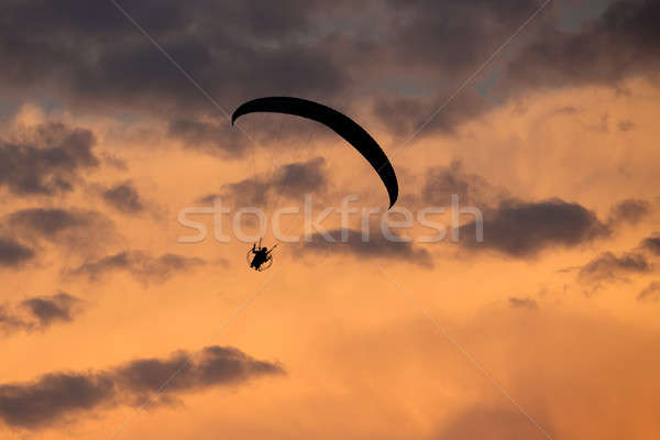 unidentified skydiver, parachutist on dramatic sky Stock photo © artush