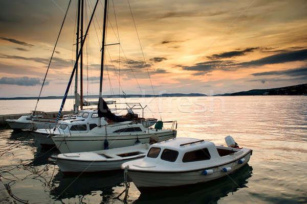 Fishing boats in Adriatic sea with sunset light Stock photo © artush