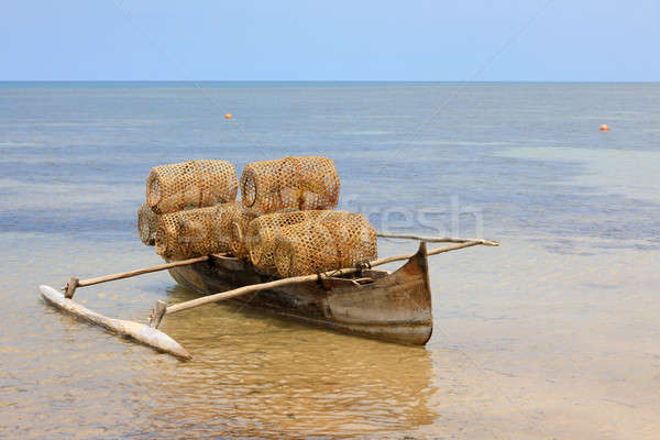 Typical malagasy fishing trap on beach Stock photo © artush