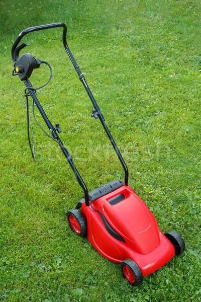 new lawnmower on green grass Stock photo © artush