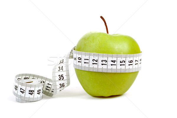 green apple with a measuring tape and heart symbol isolated Stock photo © artush