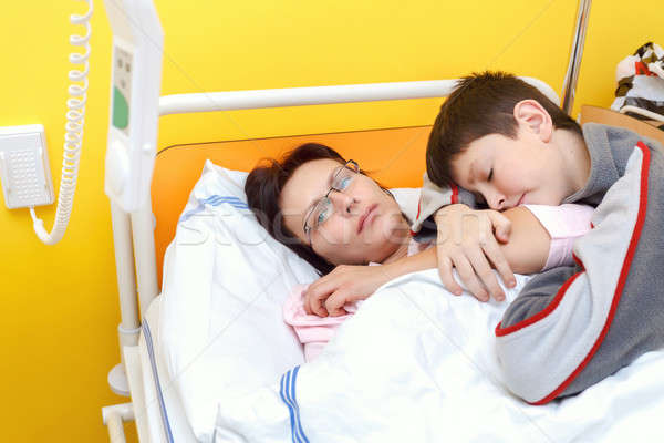 sad middle-aged woman lying in hospital with son Stock photo © artush