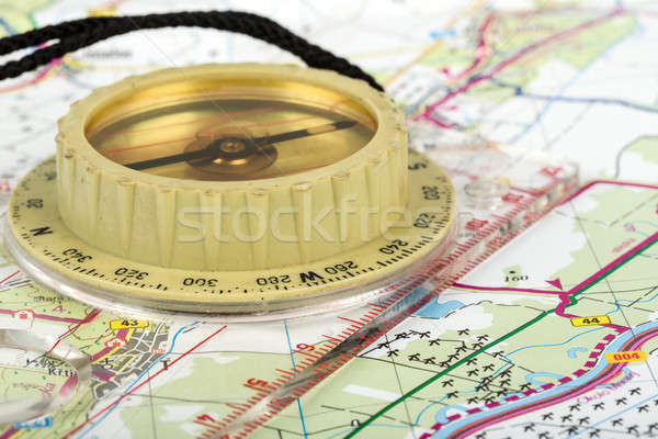 old touristic compass on map  Stock photo © artush