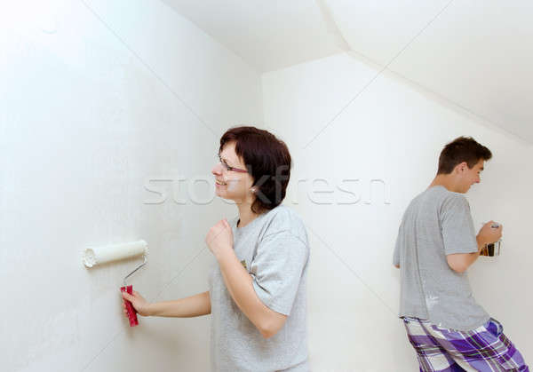 housewife with son painting wall to white Stock photo © artush