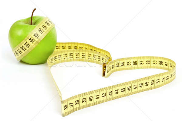 Tape measure heart shape and green apple  - health, weight concept  Stock photo © artush