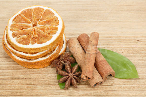 Star Anise, cinnamon and dried orange wooden background  Stock photo © artush