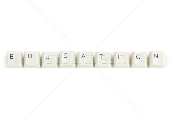 education from scattered keyboard keys on white Stock photo © artush