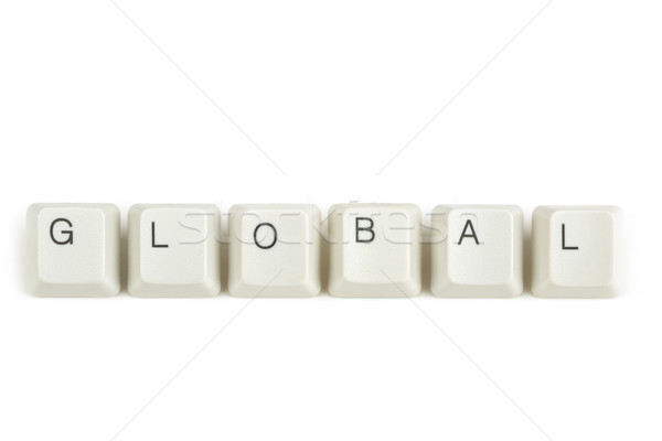 global from scattered keyboard keys on white Stock photo © artush