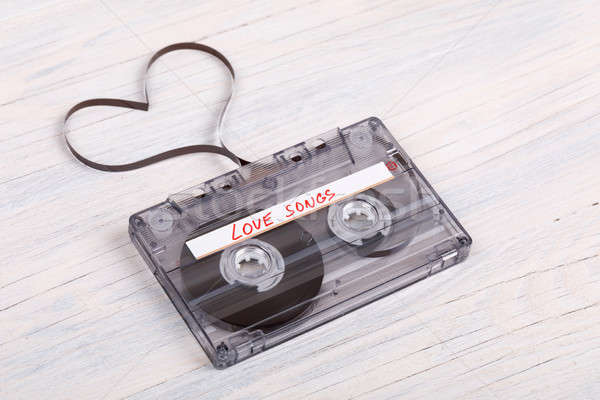 Audio cassette tape on wooden background. audio film shaping hea Stock photo © artush