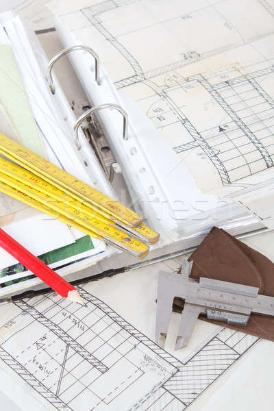Stock photo: Architectural plans of the old paper measuring tools and file with the project