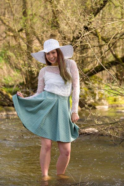 woman in spring creek Stock photo © artush