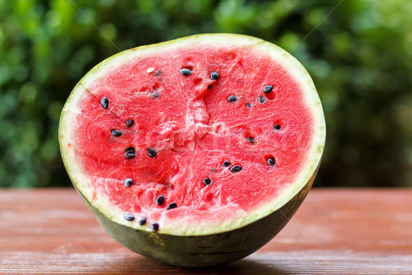 Fresh juicy watermelon against natural green background Stock photo © artush