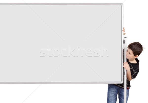 Portrait of happy little boy with white blank board Stock photo © artush