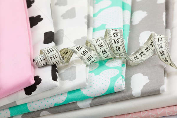 cotton fabric material and tailor measurement tape Stock photo © artush