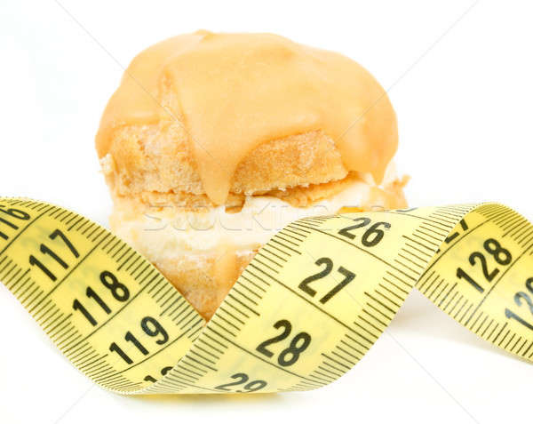 concept of slimming, caramel cake with measuring tape Stock photo © artush