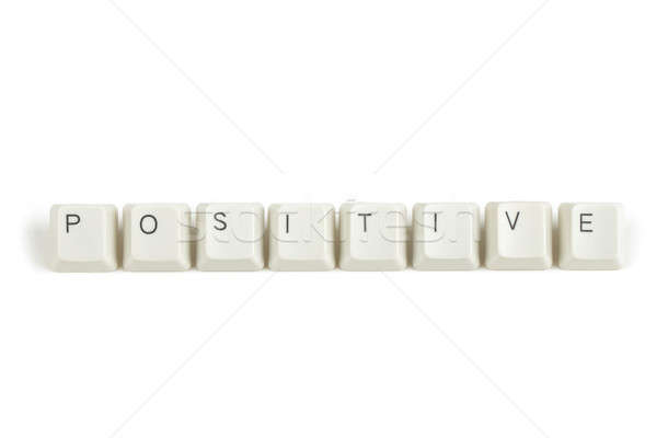 positive from scattered keyboard keys on white Stock photo © artush