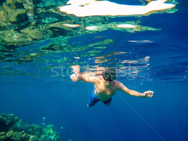 Underwater shoot of a young boy snorkeling in red sea Stock photo © artush