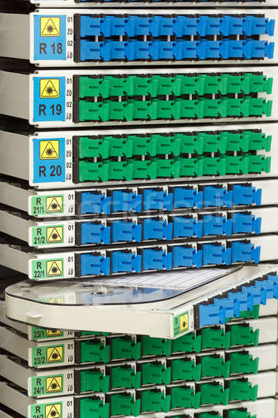 fiber optic rack with high density of blue and green SC connectors Stock photo © artush