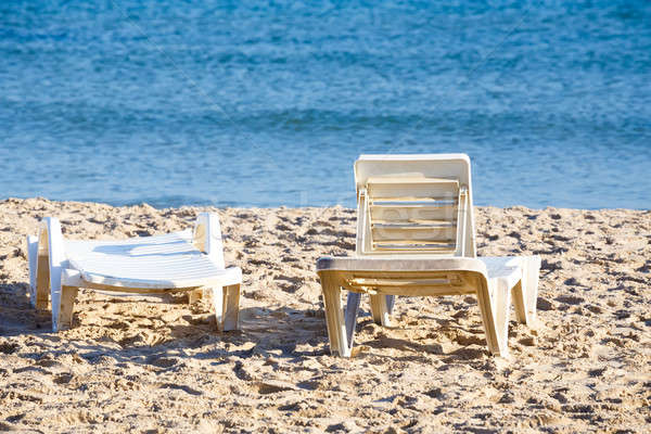 two old sunloungers on tunisian beach Stock photo © artush