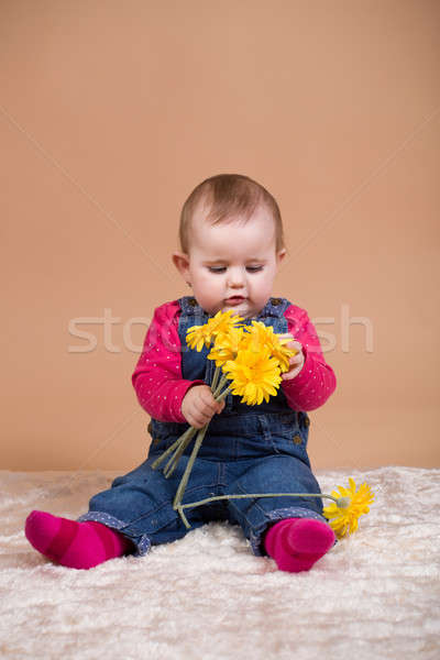 infant baby with yellow flowers Stock photo © artush