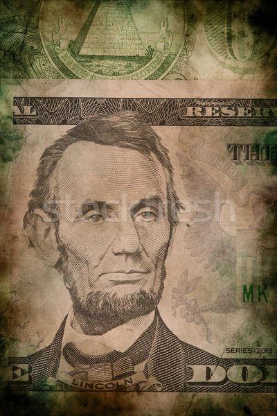 Macro of Abraham Lincoln on five USA dollar banknote grunge vintage style Stock photo © artush