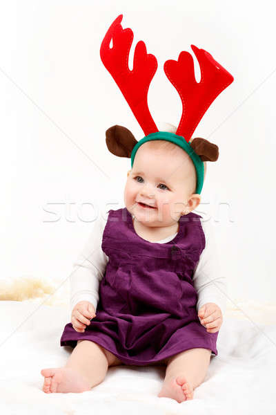 Child girl with reindeer antlers Stock photo © artush