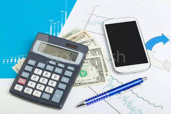 USA dollar money banknotes, calculator and mobile phone Stock photo © artush
