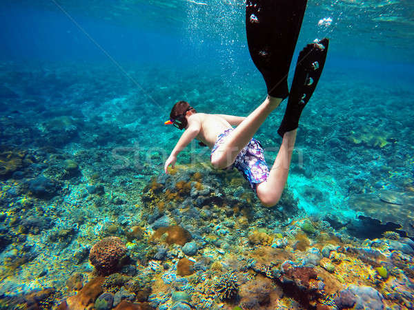 Underwater shoot of a young boy snorkeling Stock photo © artush