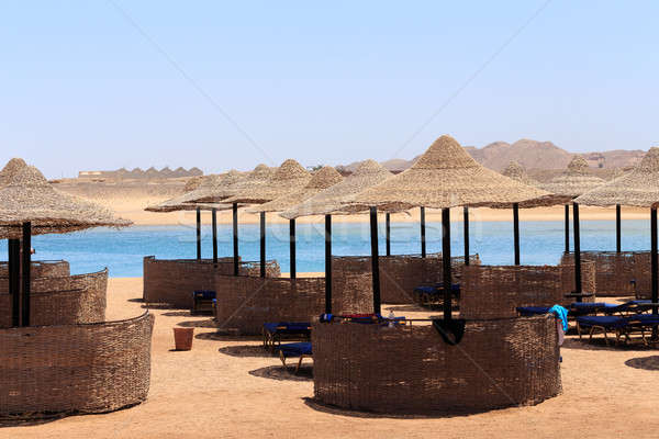 Beach sun parasol and blue sky, holliday in Egypt Stock photo © artush
