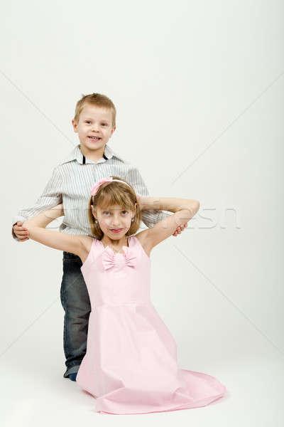 Studio portrait of siblings beautiful boy and girl Stock photo © artush
