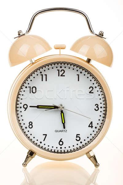 Alarm clock on a table Stock photo © artush