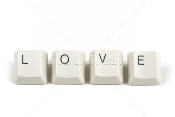 love from scattered keyboard keys on white Stock photo © artush