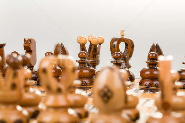 Tablero de ajedrez enfoque negro rey reina atrás Foto stock © artush
