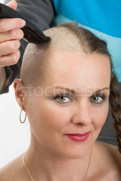 beautiful middle age woman cancer patient shaving hair Stock photo © artush